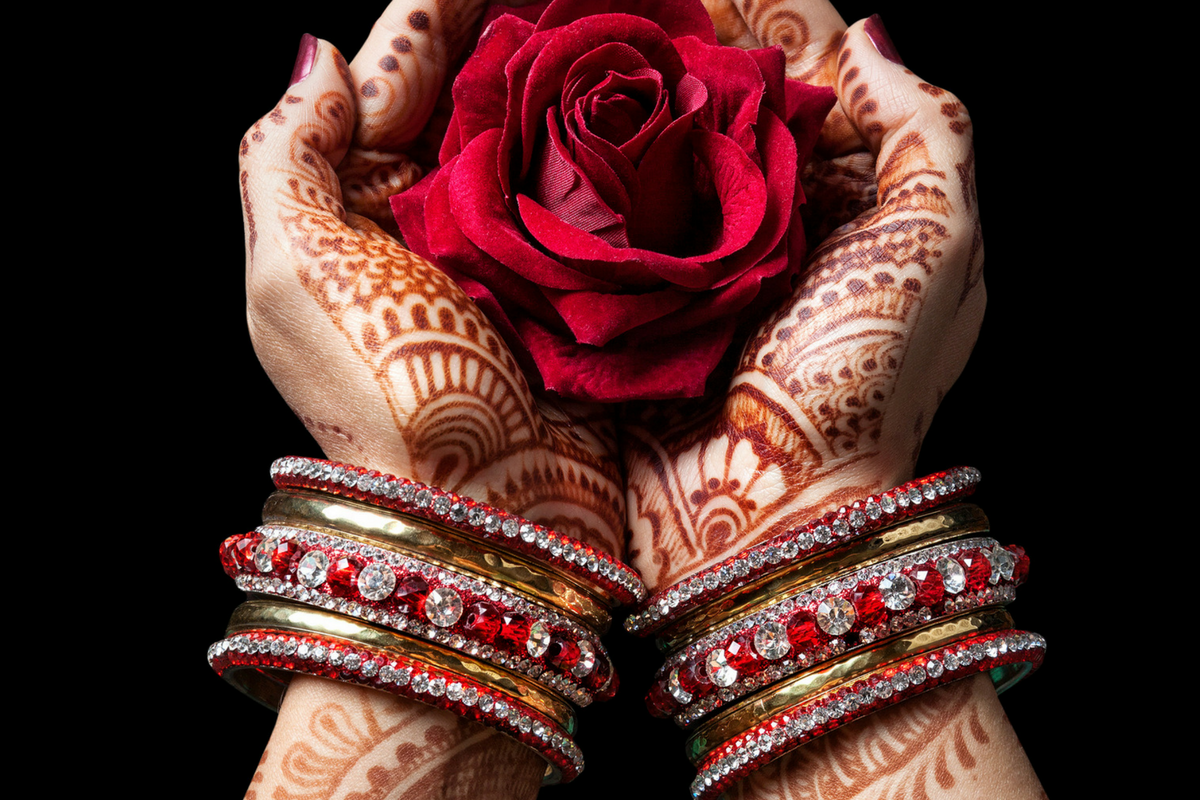 Hands holding a beautiful red rose